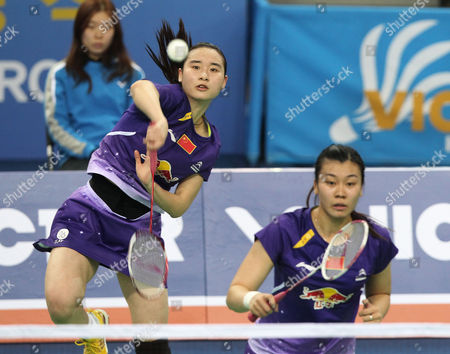 Bao Yixin, Tang Jinhua China's Bao Yixin, left, returns a shot as her teammate Tang Jinhua prepares for a return shot in their women's double final match against compatriots Luo Ying and Luo Yu at the Korea Open Badminton final in Seoul, South Korea, . China's Bao and Tang won the match 21-17, 21-15