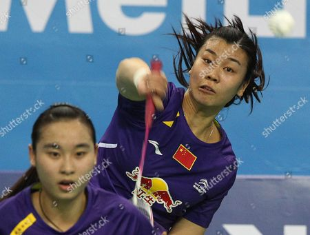 Bao Yixin, Tang Jinhua China's Tang Jinhua, right, returns a shot as her teammate Bao Yixin prepares for a return shot in their women's double final match against compatriots Luo Ying and Luo Yu at the Korea Open Badminton final in Seoul, South Korea, . China's Bao and Tang won the match 21-17, 21-15