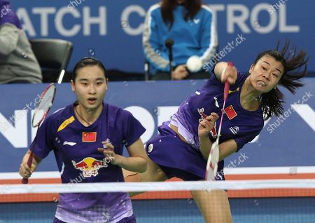 Bao Yixin, Tang Jinhua China's Tang Jinhua, right, returns a shot as her teammate Bao Yixin prepares for a return shot in their women's doubles final match against compatriots Luo Ying and Luo Yu at the Korea Open Badminton tournament in Seoul, South Korea, . China's Bao and Tang won the match 21-17, 21-15