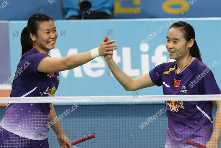 Bao Yixin, Tang Jinhua China's Bao Yixin, right, celebrates with Tang Jinhua after winning their women's doubles final match against compatriots Luo Ying and Luo Yu at the Korea Open Badminton tournament in Seoul, South Korea, . Bao and Tang won the match 21-17, 21-15
