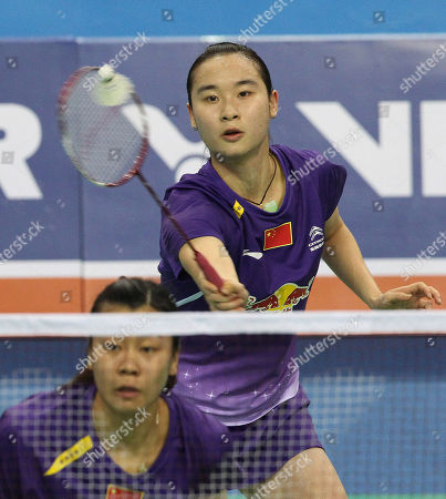 Bao Yixin, Tang Jinhua China's Bao Yixin, top, returns a shot as her teammate Tang Jinhua prepares for a return shot in their women's doubles final match against compatriots Luo Ying and Luo Yu at the Korea Open Badminton tournament in Seoul, South Korea, . Bao and Tang won the match 21-17, 21-15