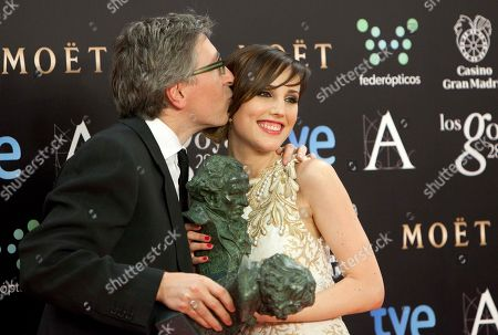"David Trueba, Natalia de Molina Spanish director David Trueba, left, kisses actress Natalia de Molina after she won the best upcoming female actress category in the film ""Vivir es facil con los ojos cerrados"" at the ""Goya"" Film Awards Ceremony in Madrid, Spain"