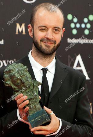 "Fernando Franco Spanish director Fernando Franco winks as he holds his Goya trophy for winning the best new director award for the film ""La Herida"" at the Goya Film Awards Ceremony in Madrid, Spain"