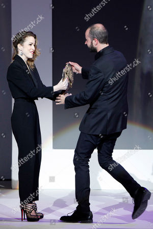 Sivia Abascal, Fernando Franco Spanish actress Sivia Abascal, left, give the Prize of Best Film to Spanish director Fernando Franco by 'La Herida' during the ceremony of the Jose Maria Forque Awards in Madrid, Spain