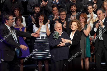 Enrique Gonzalez Macho, Jaime de Armiñan, Julia Gutierrez Caba Spanish screenwriter and film director Jaime de Armiñan, holdes the Goya of Honor in the center of the stage next to President of the Spanish Academy of Cinema Enrique Gonzalez Macho, left, and Spanish actress Julia Gutierrez Caba, right, in front of the nominees, during the Gala of Nominees to Goya Awards 2014 in Madrid, Spain
