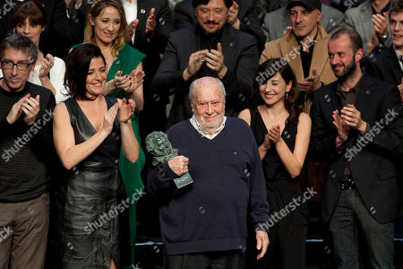 Enrique Gonzalez Macho Spanish screenwriter and film director Jaime de Armiñan, holdes the Goya of Honor in the center of the stage in front of the nominees, during the Gala of Nominees to Goya Awards 2014 in Madrid, Spain
