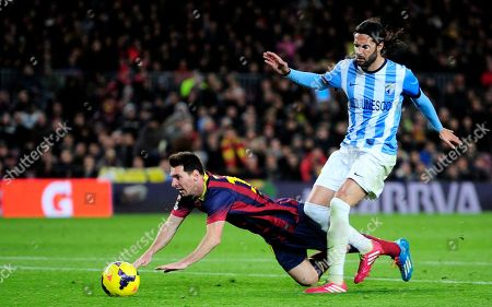 Lionel Messi, Sergio Sanchez FC Barcelona's Lionel Messi, from Argentina, left, duels for the ball against Malaga's Alexis Sanchez during a Spanish La Liga soccer match at the Camp Nou stadium in Barcelona, Spain