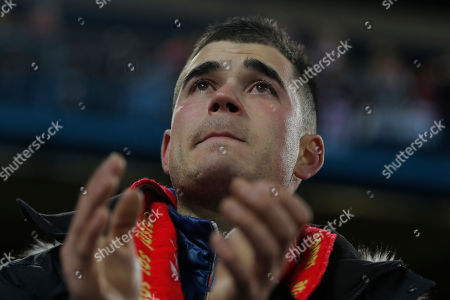 An Atletico' supporter reacts, after a minute of silence in memory of Luis Aragones prior to the Spanish La Liga soccer match between Atletico de Madrid and Real Sociedad at the Vicente Calderon stadium in Madrid, Spain