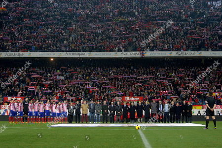 Luis Aragones Atletico's players and former players stand during a minute of silence in memory of Luis Aragones prior to Spanish La Liga soccer match between Atletico de Madrid and Real Sociedad at the Vicente Calderon stadium in Madrid, Spain, . Aragones coached the Spanish national team that won UEFA Euro 2008