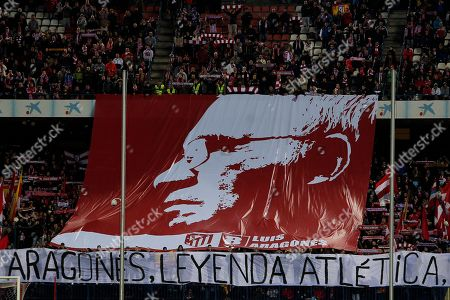 "Luis Aragones Atletico's fans display a flag reading ""Aragones, Atletico's legend"" with a picture of the late Luis Aragones, the former Spanish national coach, on it during a Spanish La Liga soccer match between Atletico de Madrid and Real Sociedad at the Vicente Calderon stadium in Madrid, Spain"