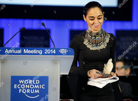 Shirin Neshat American Iranian born artist Shirin Neshat holds the Crystal award during an award ceremony at the eve of the opening of the World Economic Forum in Davos, Switzerland, . The world's financial and political elite will head this week to the Swiss Alps for 2014's gathering of the World Economic Forum at the Swiss ski resort of Davos