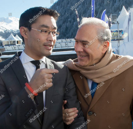 Angel Gurria, Philipp Roesler German politician Philipp Roesler, left, and Head of the Organization for Economic Co-operation and Development, OECD, Angel Gurría, right, share a light moment during the World Economic Forum in Davos, Switzerland, . The World Economic Forum is opening today where world's financial and political elite will meet in the next four coming days in Davos