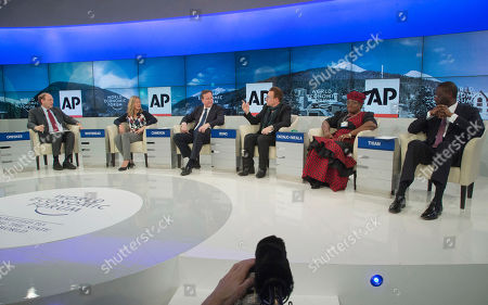 """AP Senior Managing Editor Michael Oreskes, left, moderates a discussion with, from left, Save the Children International CEO Jasmine Whitbread, British Prime Minister David Cameron, rock star Bono, Nigerian Finance Minister Ngozi Okonjo-Iweala and Tidjane Thiam, Prudential group chief executive during a panel discussion """"The Post-2015 Goals: Inspiring a New Generation to Act"""", the fifth annual Associated Press debate, at the World Economic Forum in Davos, Switzerland"""
