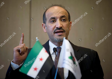 Ahmad Jarba, Syrian National Coalition (SNC) leader, Syria's main political opposition group, gestures as he reads his statement during a short press briefing in Geneva, Switzerland, . U.N.-Arab League mediator Lakhdar Brahimi tried to put a positive spin Friday on the first face-to-face meetings in three years between Syria's warring sides, suggesting they reconvene Feb. 10 for a fresh attempt at bridging the chasm between them