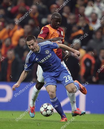 Cesar Azpilicueta, Emmanuel Eboue Emmanuel Eboue of Galatasaray, rear, and Cesar Azpilicueta of Chelsea fight for the ball during their Champions League Round of 16, First Leg soccer match between Galatasaray and Chelsea at Turk Telekom Arena Stadium in Istanbul, Turkey
