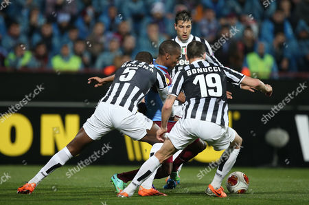 Angelo Ogbonna, Leonardo Bonucci, Florent Malouda Trabzonspor's Florent Malouda, center, is surrounded by Angelo Ogbonna, left, and Leonardo Bonucci of Juventus as they fight for the ball during their Europa League Round of 32 soccer match at Avni Aker Stadium in Trabzon, Turkey