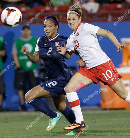 Stock Image of Sydney Leroux, Lauren Sesselmann USA forward Sydney Leroux (2) and Canada defender Lauren Sesselmann (10) chase the ball during the first half of a soccer game, in Frisco, Texas. USA won 1-0
