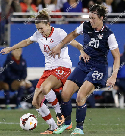 Stock Photo of Abby Wambach, Lauren Sesselmann USA forward Abby Wambach (20) and Canada defender Lauren Sesselmann (10) fight for control of the ball during the first half of a soccer game, in Frisco, Texas
