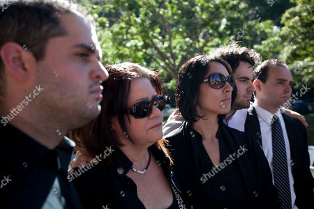 Stock Photo of Family members of the late Monica Spear, a popular soap-opera actress and former Miss Venezuela, from left to right, Javier Spear, brother, Edna Mootz, mother, Carolina Spear, cousin, Ricardo Spear, brother and Rafael Spear, brother, arrive at the East cemetery chapel for a closed memorial service in Caracas, Venezuela, . Assailants shot and killed Spear and her Irish ex-husband, Henry Thomas Berry, in the presence of their 5-year-old daughter when they resisted a robbery, authorities said. Spear and Berry were slain by the assailants late Monday night on a roadside near Puerto Cabello, Venezuela's main port, after their car broke down
