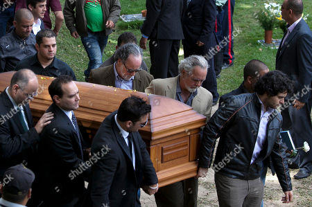 Stock Photo of Ricardo Spear Ricardo Spear, right, helps carry the coffin of his sister Monica Spear during her funeral at the East Cemetery in Caracas, Venezuela, . Robbers killed Monica Spear, a former Miss Venezuela, and her former husband Thomas Henry Berry late Monday night on an isolated stretch of highway while the couple was returning to the capital by car with their 5-year-old daughter from a vacation
