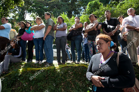 Stock Image of People attend the funeral of former Miss Venezuela Monica Spear and her ex-husband Thomas Henry Berry at the East Cemetery in Caracas, Venezuela, . Robbers killed actress Spear, 29, and her former husband Berry, 39, late Monday night on an isolated stretch of highway while the couple was returning to the capital by car with their 5-year-old daughter from a vacation