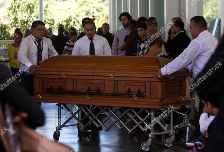 Funeral service workers push the coffin that contain the remains of Monica Spear, a popular soap-opera actress and former Miss Venezuela, into the East cemetery chapel in Caracas, Venezuela, . Assailants shot and killed Spear and her Irish ex-husband, Henry Thomas Berry, in the presence of their 5-year-old daughter when they resisted a robbery, authorities said. Spear and Berry were slain by the assailants late Monday night on a roadside near Puerto Cabello, Venezuela's main port, after their car broke down