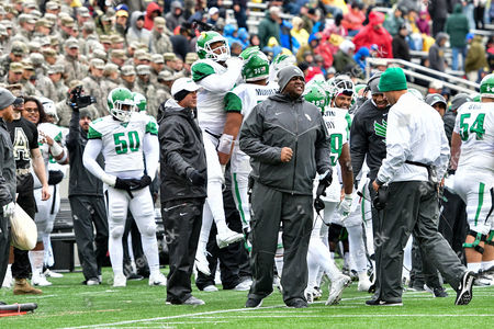 nd, .North Texas Mean Green Run Game Coordinator Brad Davis celebrates on the sideline during an NCAA College football game between the North Texas Mean Green Eagles vs Army Black Knights at Michie Stadium in West  Point, NY