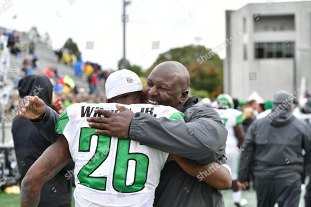 nd, .North Texas Mean Green running back Jeffrey Wilson (26) celebrates with Coach Brad Davis during an NCAA College football game between the North Texas Mean Green Eagles vs Army Black Knights at Michie Stadium in West  Point, NY
