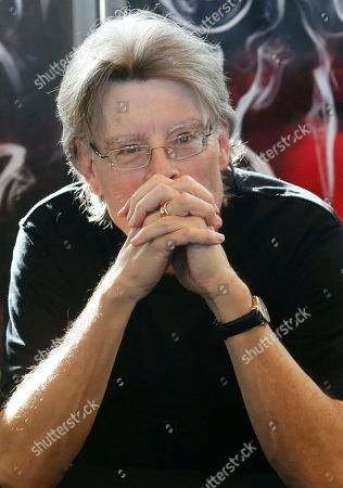 "Stephen King Author Stephen King poses for the photos prior to an autograph session during a promotional tour in France for his last book ""Doctor Sleep"" at a library in Paris. King, Nora Roberts and Robert Caro are among the hundreds of authors who have added their names to an online letter criticizing Amazon.com for restricting access to works published by Hachette Book Group"