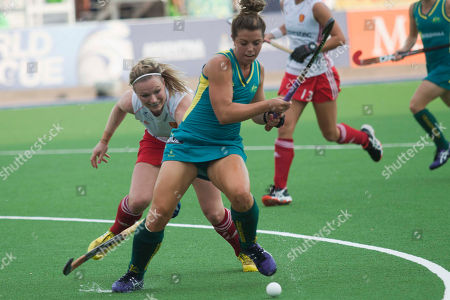 Kellie White, Georgie Twigg Australia's Kellie White, right, challenges England's Georgie Twigg during a women's field hockey World League semi final game in San Miguel de Tucuman, Argentina