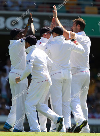 Chris Tremlett England's Chris Tremlett, right, celebrates with his teammates after he got the wicket of Australia's Steven Smith, not shown, on the first day of the series-opening Ashes test between England and Australia at the Gabba in Brisbane, Australia