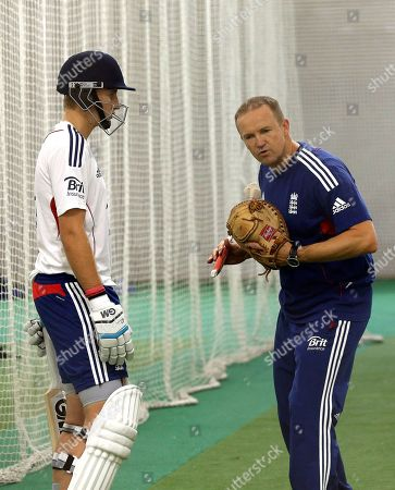 Andy Flower, Joe Root England's cricket coach Andy Flower right, instructs player Joe Root during training in Sydney, Australia, ahead of their tour match against New South Wales Xl