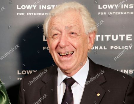 Frank Lowy Football Federation Australia Chairman Frank Lowy smiles when he greets Myanmar pro-democracy leader Aung San Suu Kyi at the Lowy Institute in Sydney. Lowy has had brain surgery for a blood clot that is thought to have arisen from his fall from the podium during the trophy presentation ceremony at the A-League grand final in May. The 84-year-old billionaire got back to his feet and completed the presentation in Melbourne on May 17, with images of his fall widely broadcast and published in Australia and abroad