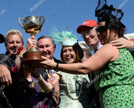 Gai Waterhouse Trainer Gai Waterhouse, center, poses with the trophy after her Fiorente, ridden by Australian jockey Damien Oliver, won the Melbourne Cup horse race at Flemington Racecource in Melbourne, Australia, . Others are unidentified