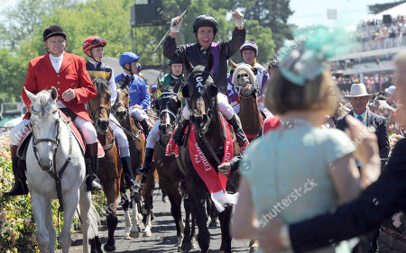 Damien Oliver Australian jockey Damien Oliver riding Fiorente celebrates as he moves towards trainer Gai Waterhouse, right, after winning the Melbourne Cup horse race at Flemington Racecource in Melbourne, Australia