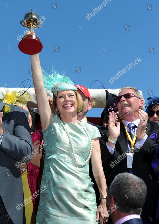 Gai Waterhouse Trainer Gai Waterhouse holds up the trophy after her Fiorente, ridden by Australian jockey Damien Oliver, won the Melbourne Cup horse race at Flemington Racecource in Melbourne, Australia