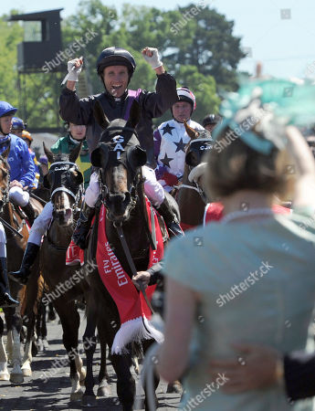 Damien Oliver Australian jockey Damien Oliver riding Fiorente celebrates as he moves towards trainer Gai Waterhouse, foreground, after winning the Melbourne Cup horse race at Flemington Racecource in Melbourne, Australia