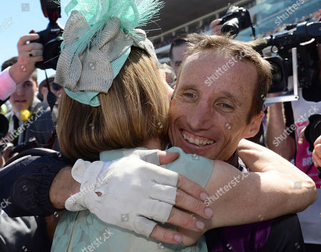 Damien Oliver Australian jockey Damien Oliver is hugged by trainer Gai Waterhouse, left, after riding Fiorente to win the Melbourne Cup horse race at Flemington Racecource in Melbourne, Australia