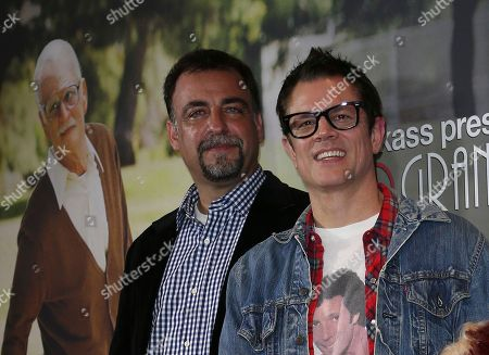 Stock Photo of Johnny Knoxville, Derek Freda Actor Johnny Knoxville, right, and producer Derek Freda pose for photos at the premiere of Bad Grandpa in Sydney