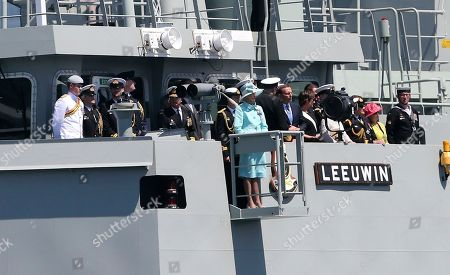 Prince Harry, Quentin Bryce Australia's Governor-General Quentin Bryce, center, and Britain's Prince Harry, left, stand onboard HMAS Leeuwin in Sydney, Australia, during the International Fleet review. The prince glided through Sydney's sun-dappled harbor aboard the navy ship on Saturday, as thousands of people crowded the shoreline to catch a glimpse of royalty and celebrate the centenary of the fledgling Australian navy fleet's first arrival to the famed waterway