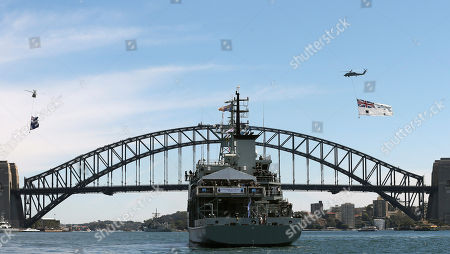 HMAS Leeuwin with Australia's Governor-General Quentin Bryce and Britain's Prince Harry, sites in front of the Harbour Bridge in Sydney, Australia, during the International Fleet review. The prince glided through Sydney's sun-dappled harbor aboard the navy ship on Saturday, as thousands of people crowded the shoreline to catch a glimpse of royalty and celebrate the centenary of the fledgling Australian navy fleet's first arrival to the famed waterway