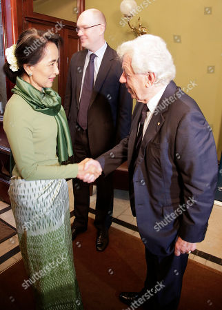 Aung San Suu Kyi Myanmar pro-democracy leader Aung San Suu Kyi, left, is met by Frank Lowy, right, as she arrives at the Lowy Institute in Sydney, . The National League for Democracy lawmaker is on a five-day trip to Sydney, Melbourne and Canberra and will make a number of speeches
