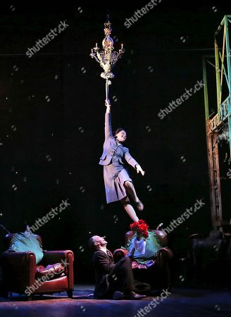 """Michelle Nightingale, Jim Sturgeon Actress Michelle Nightingale hangs from a chandelier as she and Jim Sturgeon perform on stage during a dress rehearsal for the theatre production of """"Brief Encounter"""" in Sydney, Australia, . Brief Encounter is a romantic drama which portrays a 1938 train station cafe where a house wife has a chance to meet with a doctor"""