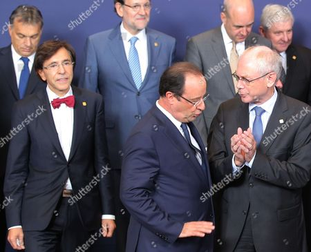 Herman Van Rompuy, Francois Hollande, Viktor Orban, Elio Di Rupo, Mariano Rajoy, Fredrik Reinfeldt, Jiri Rusnok French President Francois Hollande, front left, speaks with European Union Council President Herman Van Rompuy, front right, during a group photo at an EU summit on . A two-day summit meeting of EU leaders is likely to be diverted from its official agenda, economic recovery and migration, after German Chancellor Angela Merkel complained to U.S. President Barack Obama that U.S. intelligence may have monitored her mobile phone. Others from left to right, Hungarian Prime Minister Viktor Orban, Belgian Prime Minister Elio Di Rupo, Spanish Prime Minister Mariano Rajoy, Swedish Prime Minister Fredrik Reinfeldt and Czech Republic's Prime Minister Jiri Rusnok