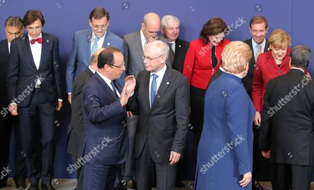 Herman Van Rompuy, Francois Hollande, Viktor Orban, Elio Di Rupo, Mariano Rajoy, Fredrik Reinfeldt, Jiri Rusnok, Angela Merkel French President Francois Hollande, front center left, speaks with European Union Council President Herman Van Rompuy, front center right, during a group photo at an EU summit on . A two-day summit meeting of EU leaders is likely to be diverted from its official agenda, economic recovery and migration, after German Chancellor Angela Merkel complained to U.S. President Barack Obama that U.S. intelligence may have monitored her mobile phone. Others from left to right, Hungarian Prime Minister Viktor Orban, Belgian Prime Minister Elio Di Rupo, Spanish Prime Minister Mariano Rajoy, Swedish Prime Minister Fredrik Reinfeldt, Czech Republic's Prime Minister Jiri Rusnok, Slovenian Prime Minister Alenka Bratusek, Lithuanian President Dalia Grybauskaite, Portuguese Prime Minister Pedro Passos Coelho, German Chancellor Angela Merkel and Cypriot President Nicos Anastasiades