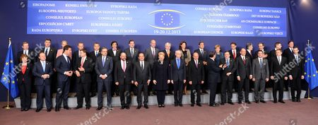 Front row left to right, European Union High Representative Catherine Ashton, Malta's Prime Minister Joseph Muscat, Dutch Prime Minister Mark Rutte, Latvian Prime Minister Valdis Dombrovskis, Greek Prime Minister Antonis Samaras, European Parliament President Martin Schultz, French President Francois Hollande, Lithuanian President Dalia Grybauskaite, European Council President Herman Van Rompuy, Romanian President Traian Basescu, Cypriot President Nicos Anastasiades, European Commission President Jose Manuel Barroso, Italian Prime Minister Enrico Letta, Luxembourg's Prime Minister Xavier Bettel, Slovakian Prime Minister Robert Fico and Secretary General of the European Council Uwe Corsepius. Back row left to right, Irish Prime Minister Enda Kenny, Croatian Prime Minister Zoran Milanovic, Danish Prime Minister Helle Thorning-Schmidt, Polish Prime Minister Donald Tusk, Belgian Prime Minister Elio Di Rupo, Spanish Prime Minister Mariano Rajoy, Swedish Prime Minister Fredrik Reinfeldt, Czech Republic's Prime Minister Jiri Rusnok, Slovenian Prime Minister Alenka Bratusek, Portuguese Prime Minister Pedro Passos Coelho, German Chancellor Angela Merkel, Finnish Prime Minister Jyrki Katainen, Austrian Chancellor Werner Faymann, Bulgarian Prime Minister Plamen Oresharksi, Estonian Prime Minister Andrus Ansip and British Prime Minister David Cameron pose for the media during a group photo at an EU summit in Brussels on . The economic crisis is on the EU summit's agenda, as well as issues ranging from defense and banking to relations with Ukraine and the crisis in Central African Republic