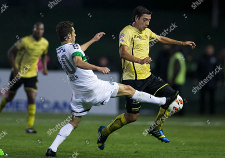 Omar Rodriguez, Lincoln Lincoln, of Brazil's Coritiba, left, fights for the ball with Omar Rodriguez, of Colombia's Itagui, during their Copa Sudamericana soccer match in Curitiba, Brazil