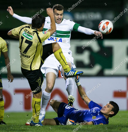 Osvaldo Cabral, Omar Rodriguez, Lincoln Goalkeeper Osvaldo Cabral, bottom, and Omar Rodriguez, left, of Colombia's Itagui, fight for the ball with Lincoln, of Brazil's Coritiba, during their Copa Sudamericana soccer match in Curitiba, Brazil