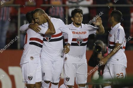 Jadson, Luis Fabiano, Aloisio, Douglas Jadson of Brazil's Sao Paulo FC, left, celebrates after scoring against Colombia's Atletico Nacional with teammates Luis Fabiano, second from left, Aloisio center, and Douglas right, during a Copa Sudamericana soccer match in Sao Paulo, Brazil
