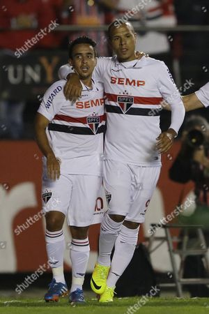 Jadson, Luis Fabiano Jadson of Brazil's Sao Paulo FC, left, celebrates after scoring against Colombia's Atletico Nacional with teammate Luis Fabiano, right, during a Copa Sudamericana soccer match in Sao Paulo, Brazil